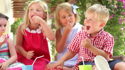 stock-footage-children-sitting-at-table-eating-jelly-with-hands-and-talking-with-friends-shot-on-canon-d-mk