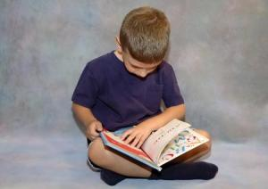 child reading a book on his own_1